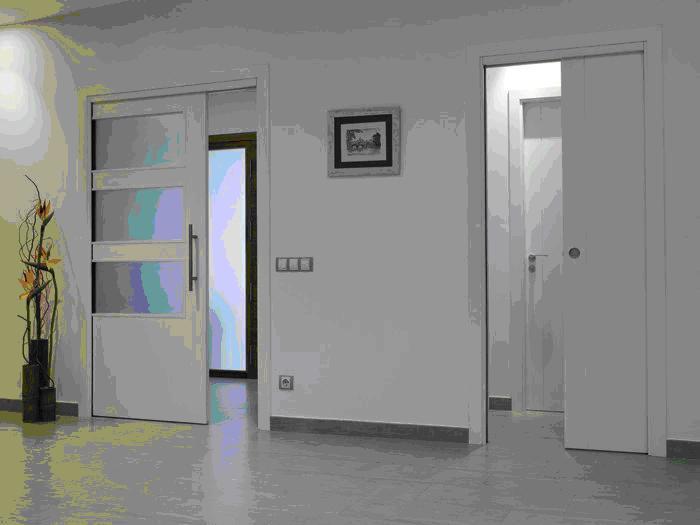 C mo instalar puertas correderas en el hogar casa y dinero - Poner puertas correderas ...